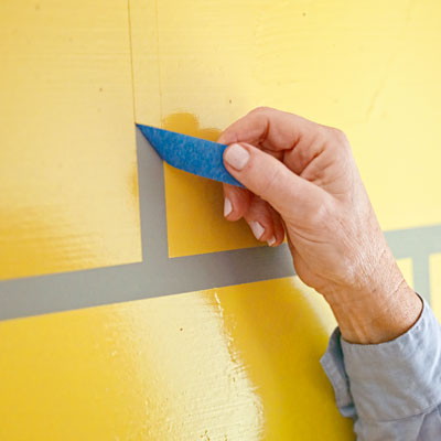removing the painter's tape to reveal the