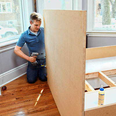 attaching the headboard of a storage bed