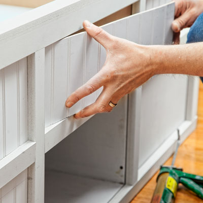 installing the paneling for a storage bed