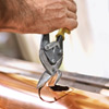 cutting the downspout holes for installing half-round gutters
