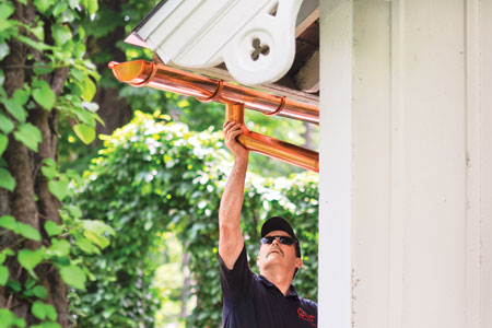 installing a half-round gutter on a house