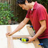 Mark Powers assembles the planter frame