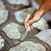 tooling the joints for building a fieldstone wall