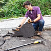 removing pieces of an asphalt driveway