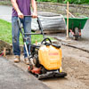 using a plate compactor to pack leveling sand
