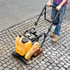 compacting a cobblestone driveway apron with a plate compactor