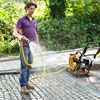spraying a cobblestone driveway apron with water to prevent grout from sticking to the top