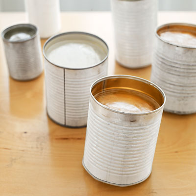 how to make tin can luminaries paint cans with ice frozen in them