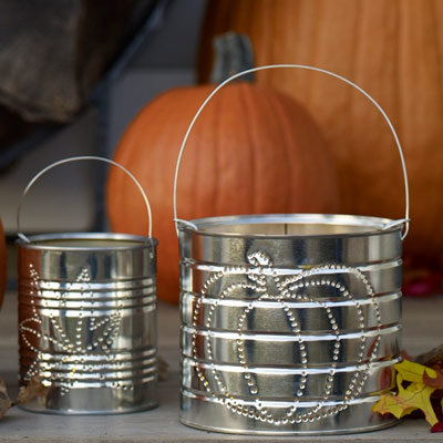 how to make tin can luminaries adding tea light