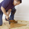 fixing a triangular nailing blank to the subfloor for a herringbone floor install