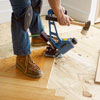 fastening the wood slats for the second course of a herringbone floor with a flooring nailer