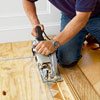 removing the excess of a herringbone pattern floor with a circular saw