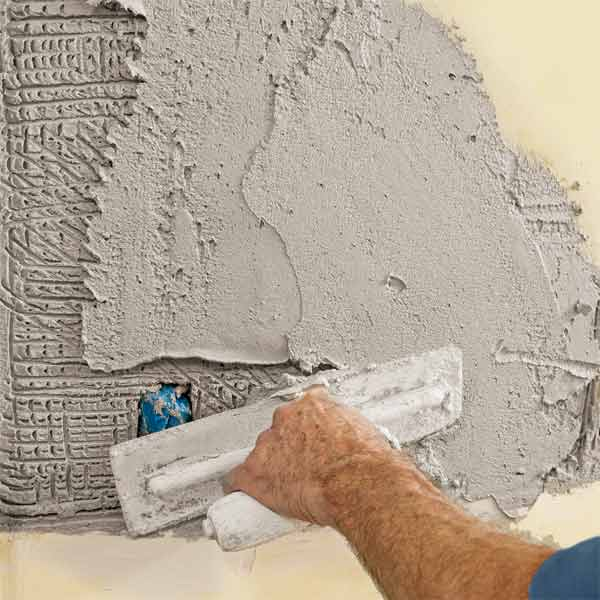 Trowel on the Second Coat How to Repair Plaster This