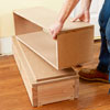 stacking the boxes for a columned room divider