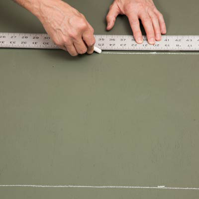 drawing lines with chalk and a yardstick