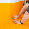how to lay a stone-tile floor roll out plastic membrane