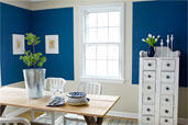 dining room painted with bands and blocks of color to mimic the look of trim