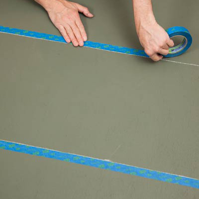taping next to the chalk lines