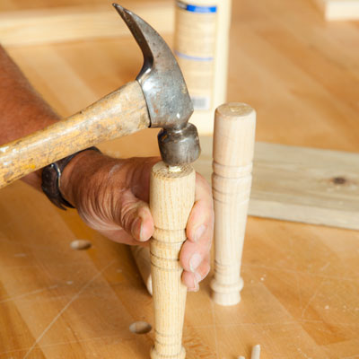 hammering dowels into the upper table legs