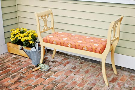 a finished garden bench made from 2 harp-backed dining room chairs