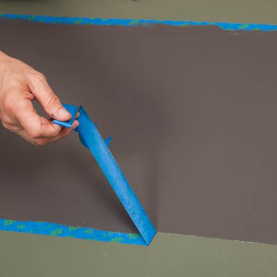 removing the tape from the painted broad bands