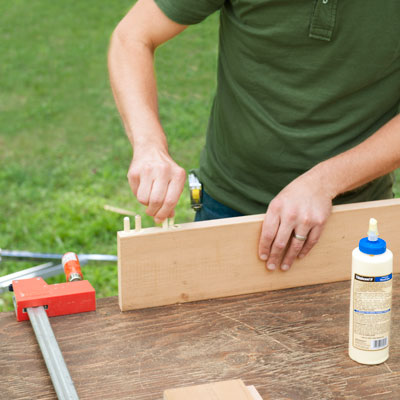 gluing dowels into rails for a picnic bench