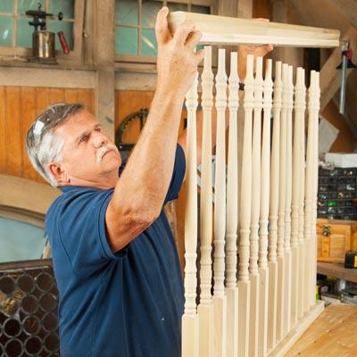 Tom Silva attaches the top rail