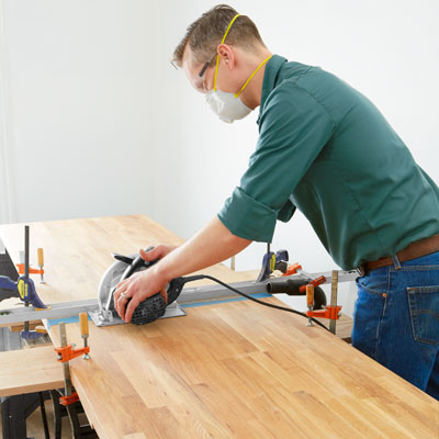 cutting the butcher-block with a circular saw