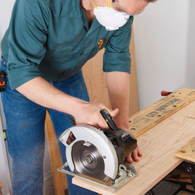crosscutting the shelf board with a circular saw
