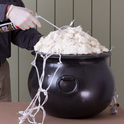 fill cauldron with expanding foam insulation for witch's cauldron halloween project