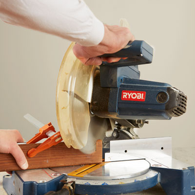 setting up a stop block to cut identical pieces with a miter saw