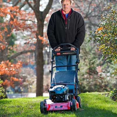 roger cook showing how to mow low to prepare your lawn for winter