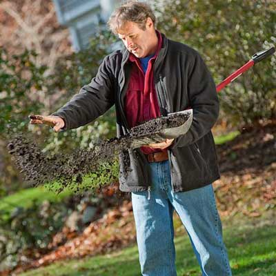 roger cook showing how to top-dress with compost and prepare your lawn for winter