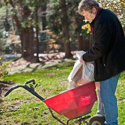 roger cook showing how to fertilize and prepare your lawn for winter