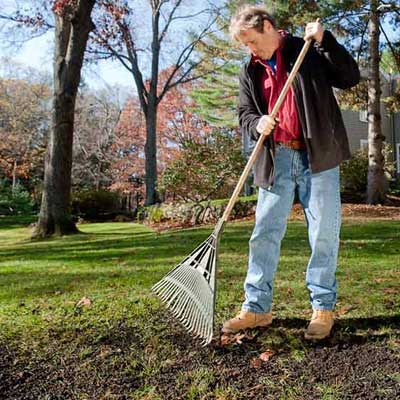 roger cook showing how to rake and water ro prepare your lawn for winter