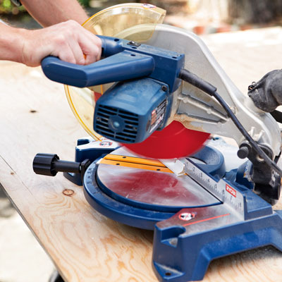 trimming the remaining molding with a miter saw