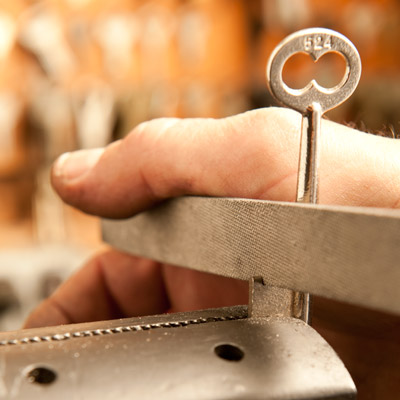file notches in the key to match the wards in the keyhole, making a new skeleton key for an old mortise door lock