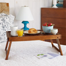 serving tray standing on a bed as an example for How to Build Folding Serving Tray