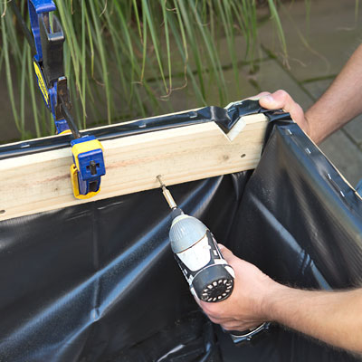 attaching the interior battens with a drill/driver to secure the pond liner