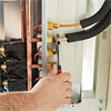 Set Up the Condenser for How to Install a Mini-Split Heat Pump