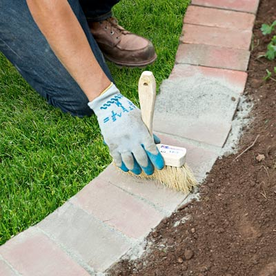 brick gaps with stone dust how to edge a garden bed with brick pavers