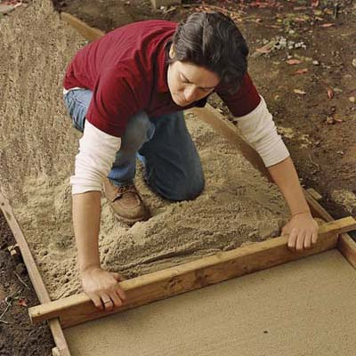 press down sand before installing a brick path, 10 uses for wood flooring scraps