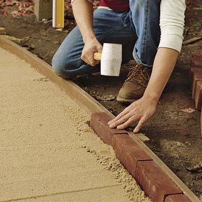 Lay the brick edging how to lay a brick path this old - How to lay brick border edging ...