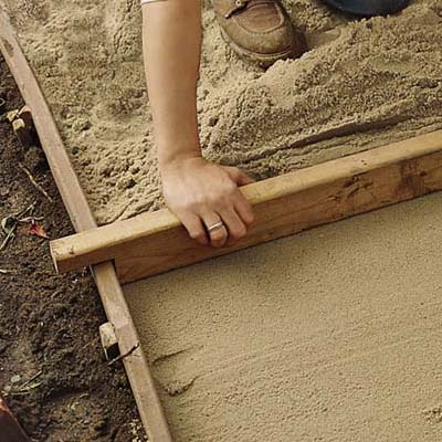 add the sand layer to make a brick path