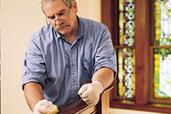 man waxing the wood