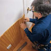 fitting wainscoting against door casing