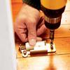 Positioning the floor bracket.