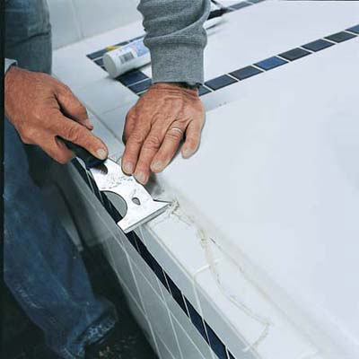 remove existing caulk how to caulk around a tub this old house. Black Bedroom Furniture Sets. Home Design Ideas