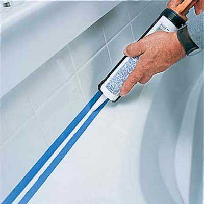 tape a caulk the joint between the tub and the surround