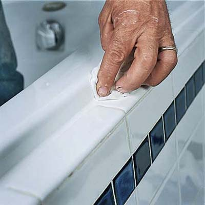 smooth the caulk with your finger and a damp rag